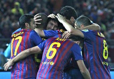 Futbolistas del FC Barcelona celebrando un gol.